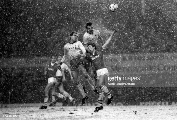 League Cup Football Everton v Oxford United Paul Hinshelwood and Gary Briggs outjump Everton striker Adrian Heath in the snow at Goodison