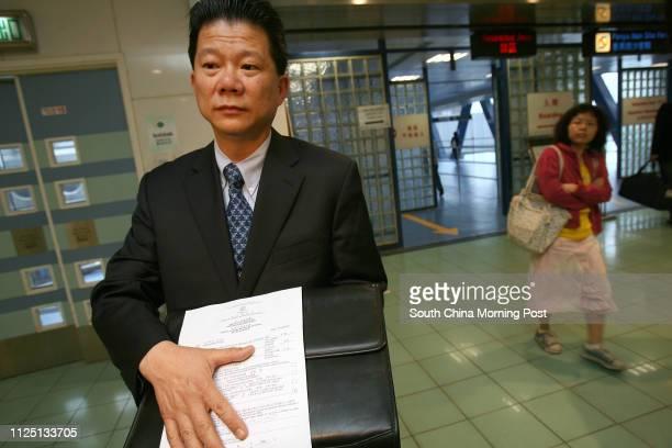 League of Social Democrats member Michael Mak Kwokfung arrives at the Macau Ferry Terminal at Shun Tak Centre showing media the refusal notice after...