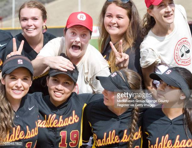 'A League of their Own' star Megan Cavanagh top left hams it up with Saddleback College softball players after an exhibition baseball game in Mission...