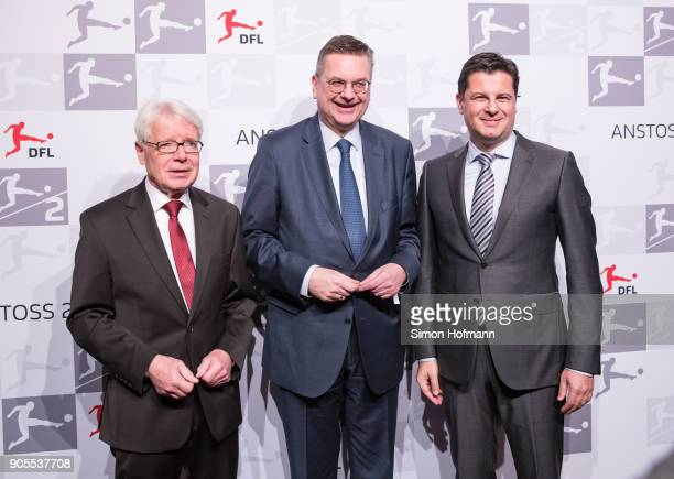 DFL League President Dr Reinhard Rauball DFB President Reinhard Grindel and DFL CEO Christian Seifert pose during the 2018 DFL New Year Reception at...