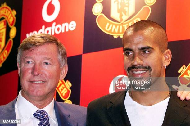 Manchester United's new signing Juan Sebastian Veron poses for photographers with manager Sir Alex Ferguson before a press conference at Old Trafford...