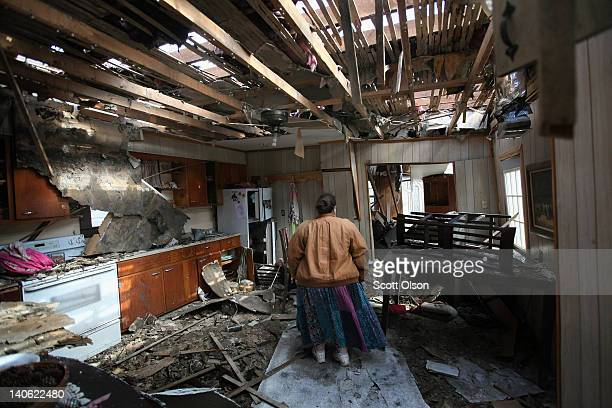 Leah Boylan looks at the damage to her sister's home after it was destroyed by yesterday's tornado March 3 2012 in Henryville Indiana Dozens of...