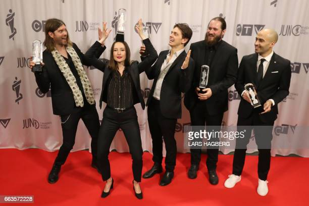 Leah Fay of the July Talk balances her JUNO award atop her head during the JUNO gala at the Shaw Centre in Ottawa Canada April 1 2017 / AFP PHOTO /...