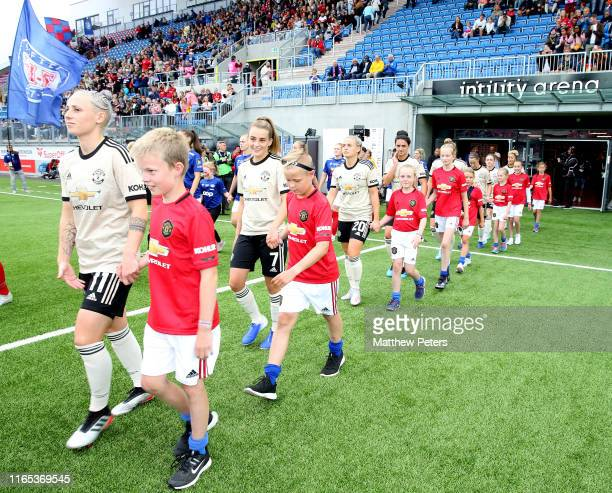 Leah Galton and Ella Toone of Manchester United Women walk out ahead of the preseason friendly match between Valerenga and Manchester United Women at...