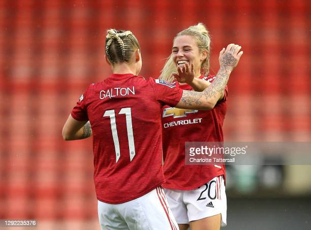 Leah Galton of Manchester United celebrates Kirsty Smith after scoring their team's first goal during the Barclays FA Women's Super League match...