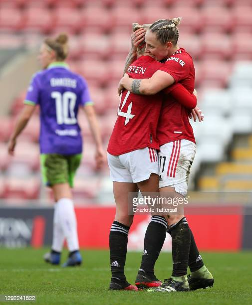 Leah Galton of Manchester United celebrates with Jackie Groenen after scoring their team's fourth goal during the Barclays FA Women's Super League...