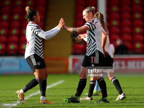 Leah Galton of Manchester United celebrates with teammate Lauren James after scoring her team's first goal during the Barclays FA Women's Super...
