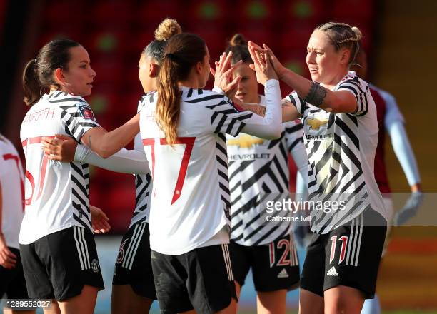Leah Galton of Manchester United celebrates with teammate Tobin Heath after scoring her team's first goal during the Barclays FA Women's Super League...