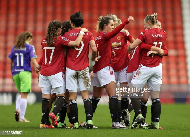 Leah Galton of Manchester United celebrates with teammates after scoring their team's first goal during the Barclays FA Women's Super League match...