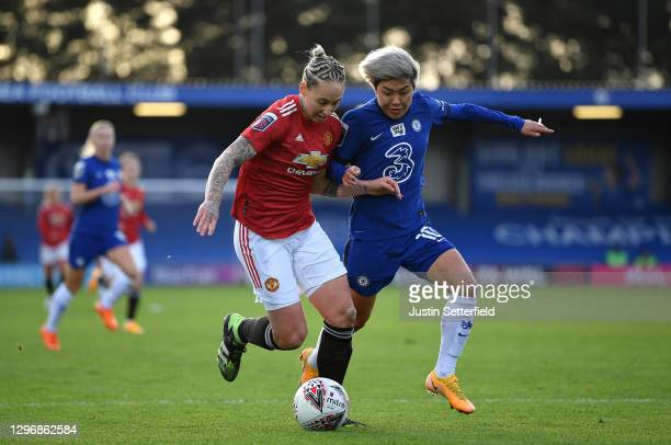 Leah Galton of Manchester United looks to break past Ji So-Yun of Chelsea during the Barclays FA Women's Super League match between Chelsea Women and...