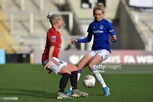 Leah Galton of Manchester United Women and Molly Pike of Everton Women in action during the Barclays FA Women's Super League match between Manchester...