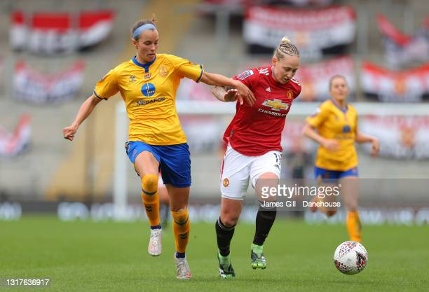 Leah Galton of Manchester United Women holds off a challenge from Rikke Sevecke of Everton Women during the Barclays FA Women's Super League match...