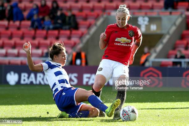 Leah Galton of Manchester United Women is challenged by Fara Williams of Reading Women FC during the Barclays FA Women's Super League match between...