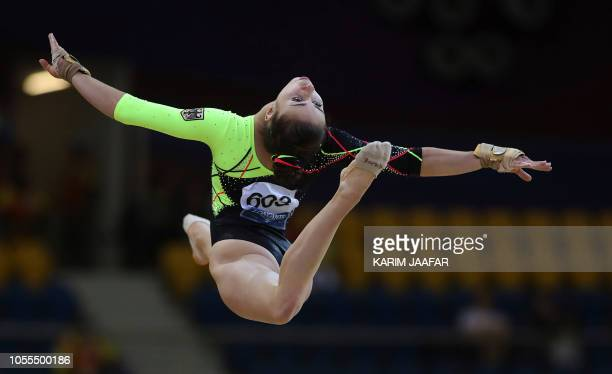 TOPSHOT Leah Griesser of Germany competes in the floor during women's team final of the 2018 FIG Artistic Gymnastics Championships at Aspire Dome on...