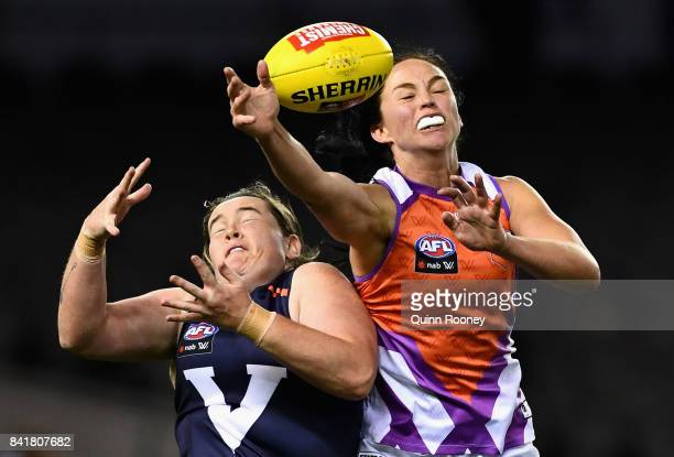 Leah Kaslar of the Allies and Sarah Perkins of Victoria compete for a mark during the AFL Women's State of Origin match between Victoria and the...