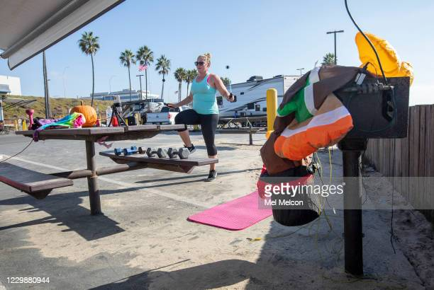 Leah Llere does a high intensity interval training workout outside her RV camper at Dockweiler Rv Park in Playa del Rey. She arrived a week ago with...
