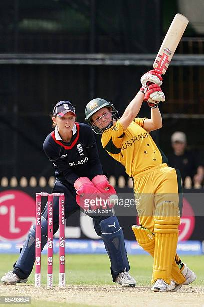Leah Poulton of Australia attempts to hit out but is later stumped during the ICC Women's World Cup 2009 Super Six match between Australia and...