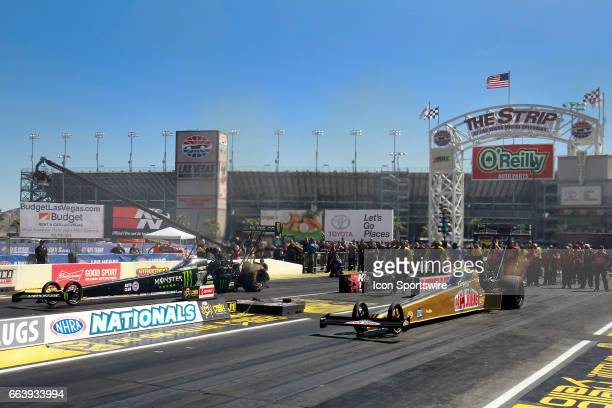 Leah Prichett NHRA Top Fuel Dragster launches off the line against Brittany Force John Force Racing NHRA Top Fuel Dragster during the 18th Annual...