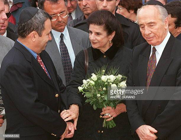 Leah Rabin the wife of late Israeli Premier Yitzhak Rabin talks to former Israeli Labor party leader Shimon Peres and his successor Ehud Barak during...