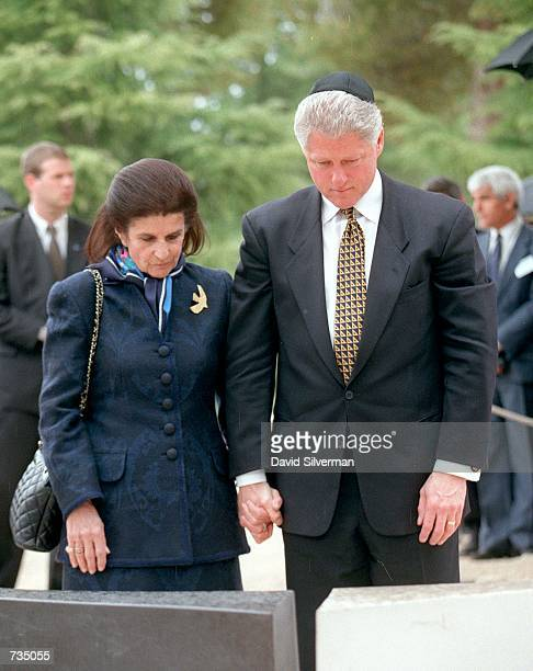 Leah Rabin, wife of assassinated Israeli Prime Minister Yitzhak Rabin, and United States President Bill Clinton mourn at his grave March 14,1996 in...