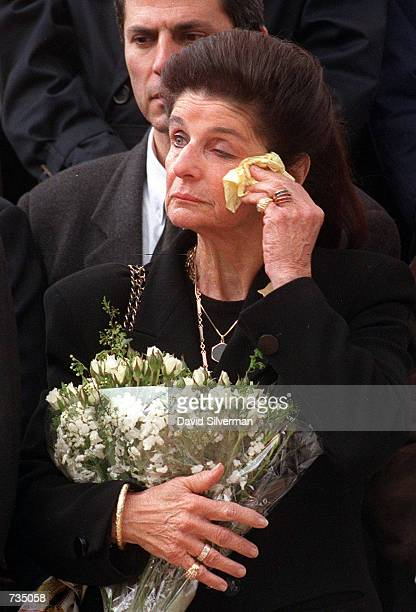 Leah Rabin, wife of assassinated Israeli Prime Minister Yitzhak Rabin, wipes away her tears at the unveiling of Rabin's tombstone March 1, 1996 in...