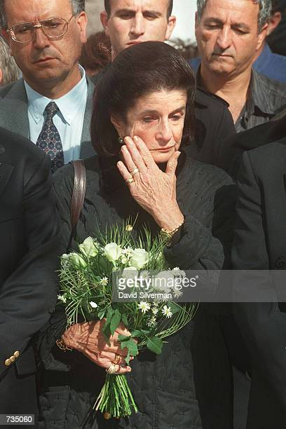 Leah Rabin, wife of assassinated Israeli Prime Minister Yitzhak Rabin, wipes away her tears November 4,1997 as she visits his grave on the 2nd...