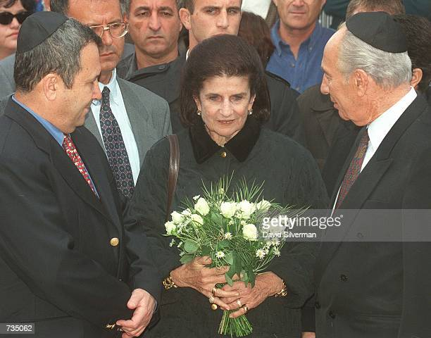 Leah Rabin, wife of assassinated Israeli Prime Minister Yitzhak Rabin, is flanked by Prime Minister Ehud Barak, left, and former Prime Minister...