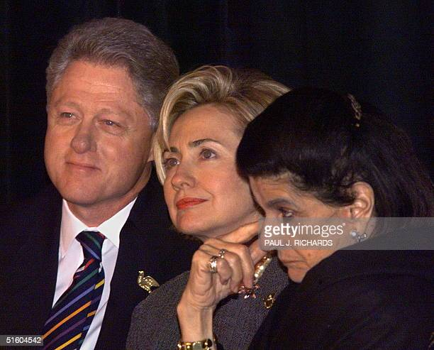 Leah Rabin wife of slain Israeli Prime Minister Yitzhak Rabin wipes her eye as US President Bill Clinton and First Lady Hillary Clinton watch an...