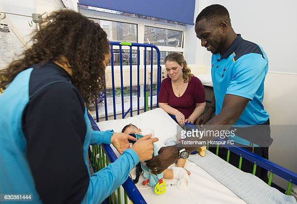 Leah Rawle and Moussa Sissoko of Tottenham Hotspur hand out presents to patients at Whipps Cross Hospital on December 21 2016 in London England