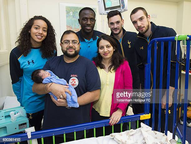 Leah Rawle Moussa Sissoko Hugo Lloris and Pau Lopez of Tottenham Hotspur hand out presents to patients at Whipps Cross Hospital on December 21 2016...
