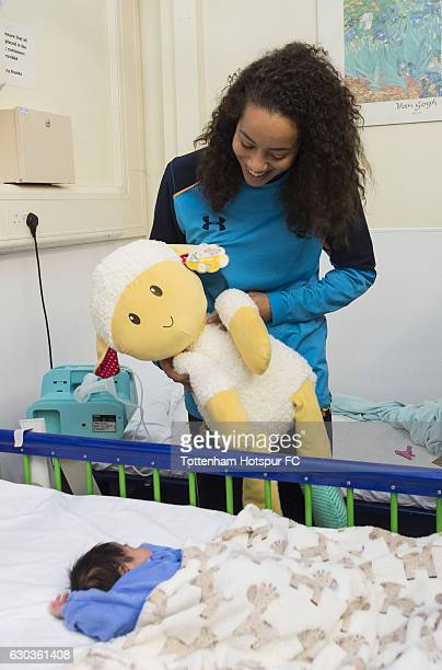 Leah Rawle of Tottenham Hotspur hands out presents to patients at Whipps Cross Hospital on December 21 2016 in London England