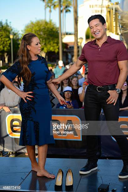 Leah Remini and Mario Lopez visit Extra at Universal Studios Hollywood on November 3 2014 in Universal City California