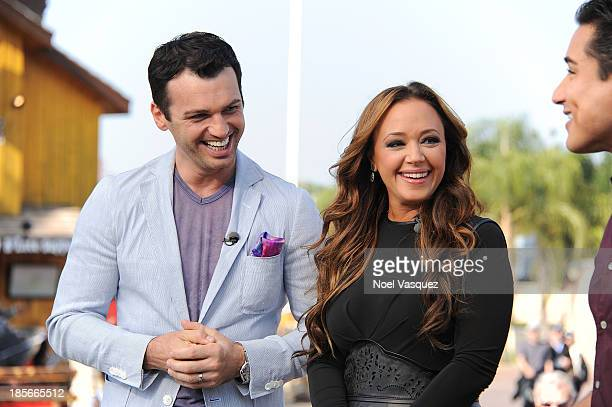 Leah Remini and Tony Dovolani visit Extra at Universal Studios Hollywood on October 23 2013 in Universal City California