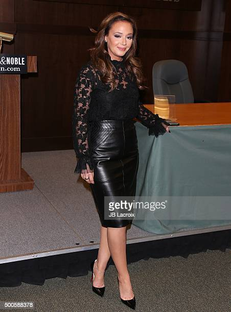 "Leah Remini signs copies of her new book ""Troublemaker: Surviving Hollywood and Scientology"" on December 8, 2015 in Los Angeles, California."