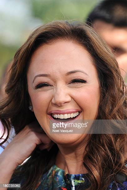 Leah Remini visits 'Extra' at Universal Studios Hollywood on September 10 2013 in Universal City California