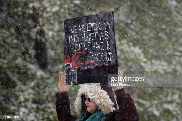 Leah Stein of Parker Colorado holds a sign while protesting at the People's Climate March on Denver on April 29 2017 in Denver Colorado The protest...
