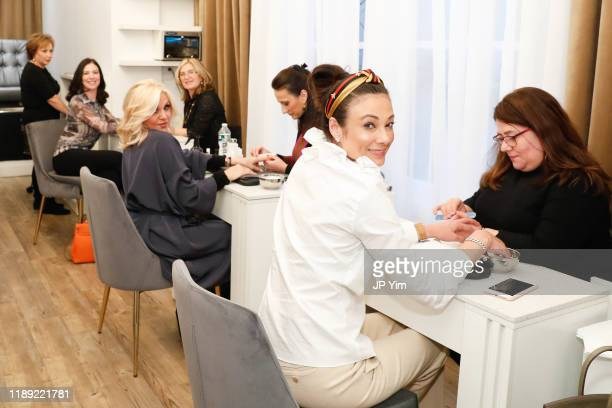 Leah Tehrani Orfeh and Lisa Baquero attend the Roman K Salon Madison Avenue Opening on November 21 2019 in New York City