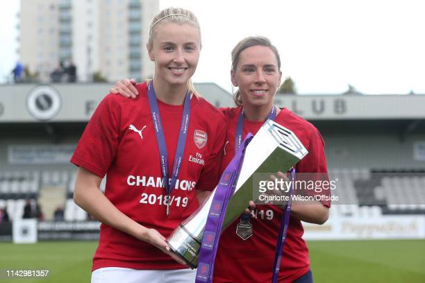 Leah Williamson and Jordan Nobbs pose with the trophy during the Women's Super League match between Arsenal Women and Manchester City Women at Meadow...