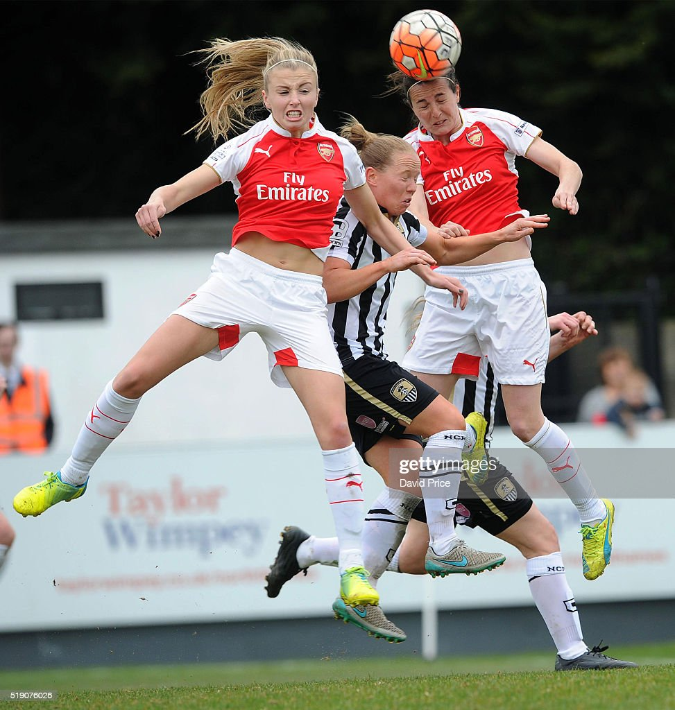 Leah Williamson and Natalia Pablos Sanchon of Arsenal Ladies jump for the ball with Danielle Buet of Notts County Ladies during the match between Arsenal Ladies and Notts County Ladies at Meadow Park on April 3, 2016 in Borehamwood, England.