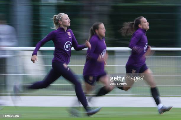 Leah Williamson and team mates run during an England training session during the 2019 FIFA Women's World Cup France at Stade Commandante Hebert on...