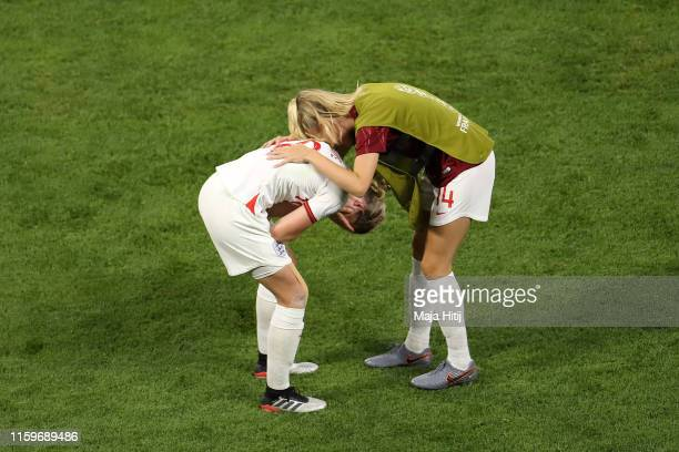 Leah Williamson consoles teammate Ellen White of England following their team's defeat in the 2019 FIFA Women's World Cup France Semi Final match...