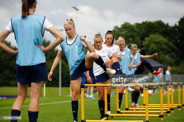 Leah Williamson, Georgia Stanway and Caroline Weir of Great Britain warm up during the Team GB Football Camp at Loughborough University on July 03,...