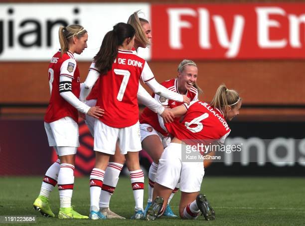 Leah Williamson of Arsenal celebrates with her team mates after scoring her sides second goal during the Barclays FA Women's Super League match...