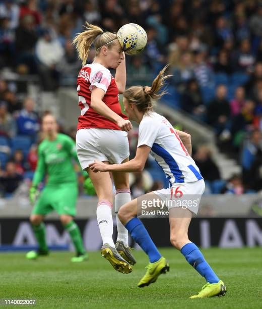 Leah Williamson of Arsenal heads the ball away from by Ellie Brazil of Brighton during the match between Brighton & Hove Albion Women and Arsenal...