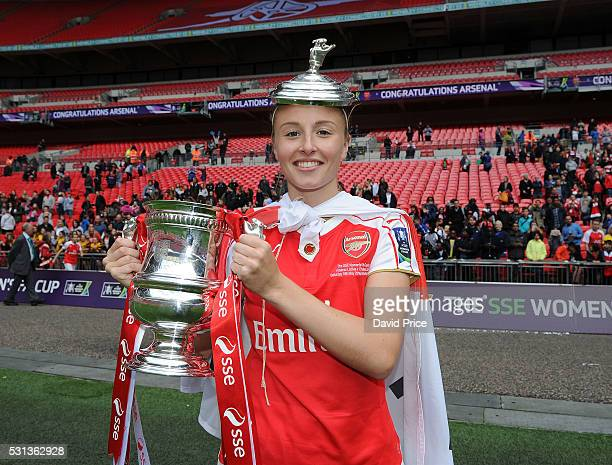 Leah Williamson of Arsenal Ladies lifts the FA Cup Trophy the match between Arsenal Ladies and Chelsea Ladies at Wembley Stadium on May 14 2016 in...