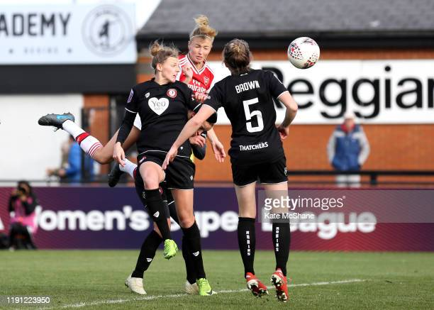 Leah Williamson of Arsenal scores her sides second goal as Yana Daniels of Bristol City Women attempts to defend during the Barclays FA Women's Super...
