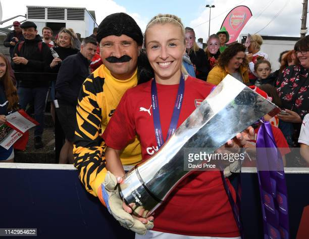 Leah Williamson of Arsenal with the WSL Trophy and a family member dressed as David Seaman after the match between Arsenal Women and Manchester City...
