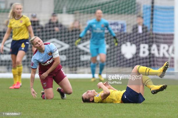 Leah Williamson of Arsenal Women down injured from Gilly Flaherty of West Ham United Women's tackle during the Women's FA Cup match between West Ham...