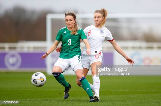 Leah Williamson of England battles for possession with Simone Magill of Northern Ireland during the Women's International Friendly match between...