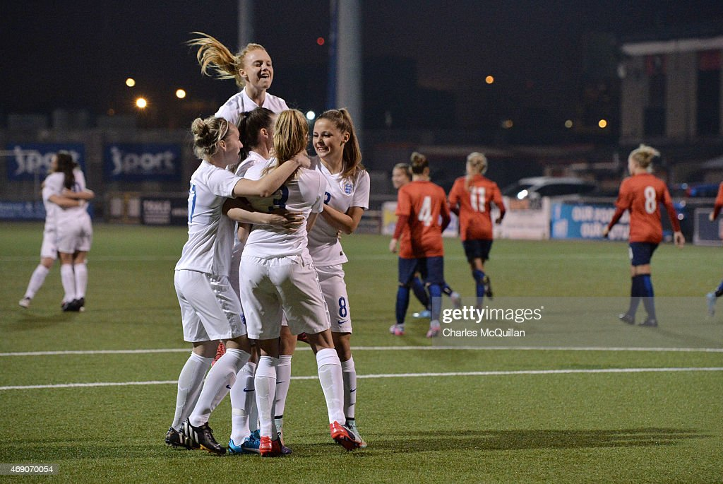 Leah Williamson of England celebrates with team mates after a retaking a last minute penalty during the UEFA U19 Women's Qualifier between England and Norway at Seaview on April 9, 2015 in Belfast, Northern Ireland. The original penalty, taken during the game played on Saturday April 4, 2015, was incorrectly disallowed by the match official and the retaking of the penalty, with both teams in attendance, was ordered by UEFA.